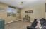 Your front entry room is perfect for an office or play room!