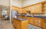 Solid wood and granite and stainless appliances