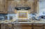 Beautiful matching granite throughout all kitchen, laundry room and bath areas