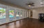 Overlooks pool - this area is great for pool table, formal dining room or drawing/painting room!
