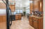 Kitchen offers extra cabinets with a perfect beverage bar.