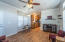 """Wood look vinyl plank flooring, ceiling fan with lights, crown molding, 2"""" wood blinds, ceiling vents for heat and ac."""