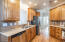 """Kitchen offers 42"""" upper cabinets, Corian countertops, pantry cabinets and all appliances."""