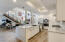 High end white cabinetry in this beautiful kitchen offers tons of storage