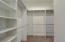 Huge walk-in closet with plenty of storage for the downstairs primary bed/bathroom