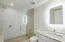 Ensuite bathroom for bedroom 4 is also elegant and well-appointed