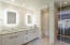 Upstairs primary bathroom is luxurious and elegant, with dramatic lighting