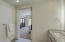 Very well appointed bathroom with rich granite counters