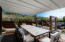 Beautiful pergola with retractable cover and custom lighting offers plenty of space to entertain