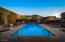 The beautiful, sparkling community pool is just steps away and features some terrific views