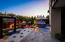 Custom lighting in this beautiful backyard gives a very dramatic effect