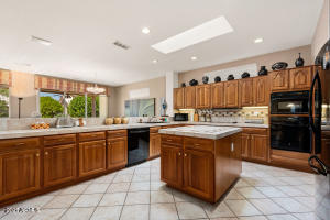 Large kitchen island, cabinets have roll outs