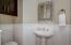 Powder room with wainscoting and storage cabinet