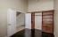 Double doors, wood flooring, could be 4th bedroom