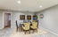 Ample space for a formal dining setup within the expansive kitchen area