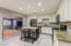 The kitchen has the front entrance living area on one side and the spacious great room on the other side.
