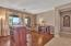 Living room has a fireplace and bar that can convey on separate bill of sale. Private master bedroom has its own wing.