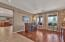 Rich wood floors enhance the living room, downstairs office & master.