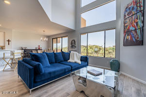 Towering floor to ceiling windows to breathe in golf course views.