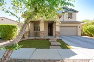 Beautiful Home with front porch and synthetic turf in front yard.