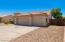 3 car garage + RV gate and easy care desert landscaping.