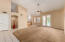 Open concept with Family Room flowing into Kitchen. Double doors leading to the pool.