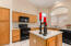 Roomy Kitchen with center island and ample counter space for entertaining.