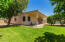 Fun, grassy area, shade and citrus trees and Tuf Shed in the backyard.