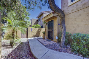 Updated Corner/End unit.  Light, bright and airy throughout this 1 bedroom condo situated in the ''magic'' zip code of Scottsdale. This lightly lived in home features vaulted ceilings, updated kitchen and bathrooms. Kitchen features quartz countertops and reverse osmosis system. New HVAC in 2016 and newer water heater. Master bedroom includes french door entry enclosing small seating area for privacy. Master bathroom has two beautifully updated vanities with Ikea closet storage system. Indoor laundry includes lightly used washer and dryer. Balcony allows outdoor space for seating and mountain views. Spacious 2 car garage with direct entry to the home. Gated pool, BBQ, and ramada. Central location near 101, Mayo clinic and Kierland area.