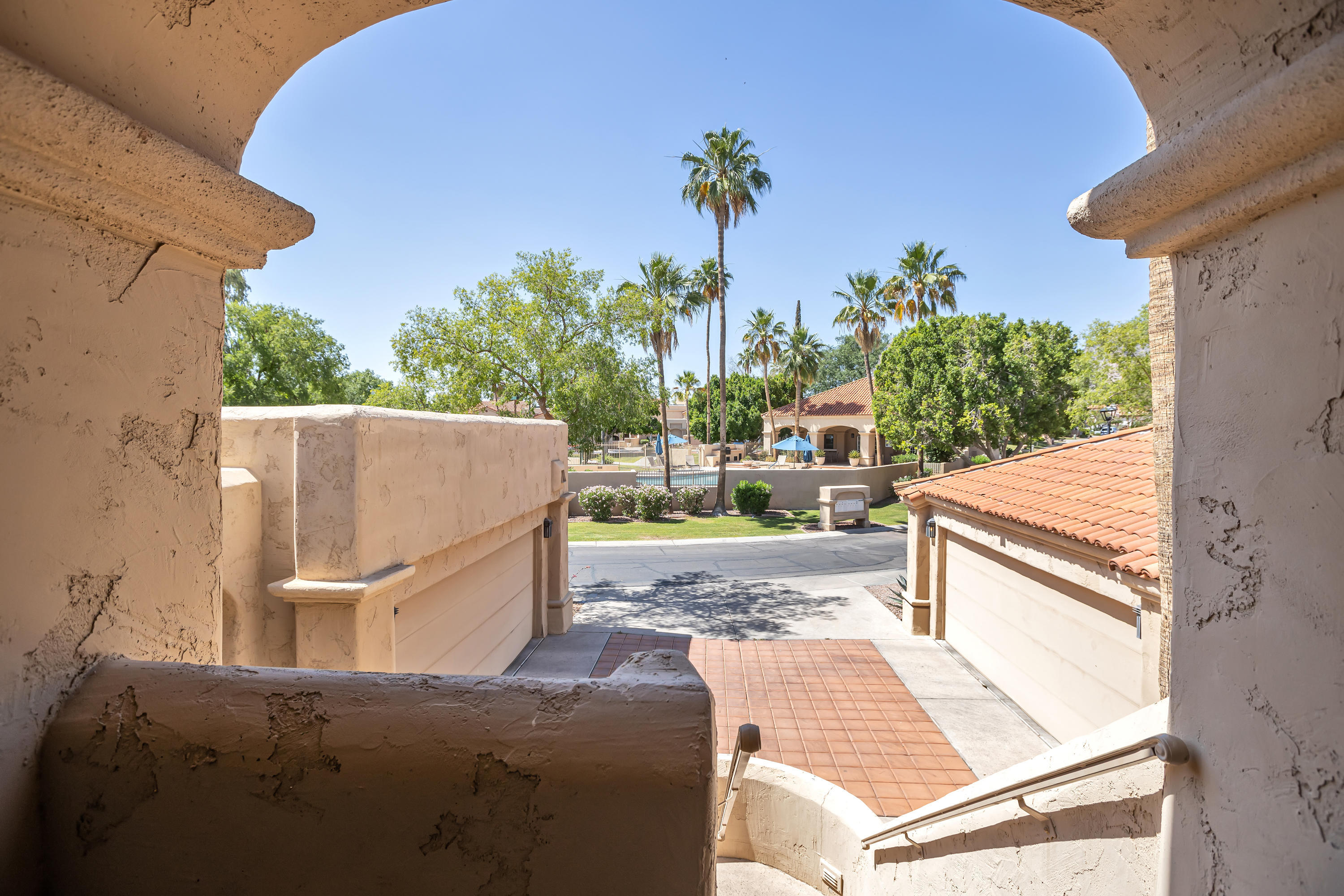 This is the nicest, unfurnished Biltmore Courts II rental on the market at this time or in the recent past in the prestigious Arizona Biltmore. Great contemporary home with terrific upgrades, including:  wood floors, fresh paint, stainless appliances,  pedestal sinks in the baths, which are just a few of the features. Vaulted ceilings, fireplace in living room, lovely patio with views of the lake on the 12th hole of the Links golf course, Wrigley Mansion, and downtown skyline. Conveniently located to the excellent dining, entertainment, movies, and shopping at Biltmore Fashion Park and along Camelback Corridor. Biking/hiking/running paths along the canal; community heated pool and spa, and tennis courts. 15 minutes to downtown, Scottsdale, airport 5 minutes to I-51.