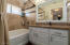 3/4 main bath with beautiful stonework on counters and shower tub area