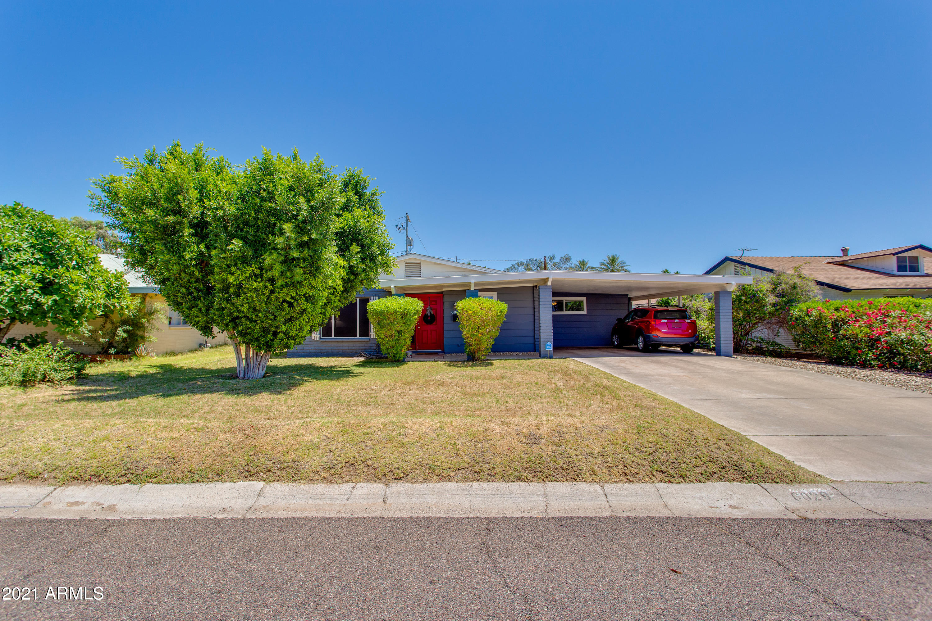 *Please note: there is a tenant in place through February 2022* This beautiful ranch home is in a prime location just around the corner from The Vig Uptown, Dick's Hideaway, and the AZ-51 freeway. Featuring exposed slump block, engineered wood flooring, clean paint, and shaker style cabinetry throughout, this updated North Central property is sure to please. The interior layout offers three bedrooms, a spacious den/office with laundry closet, and an open, eat-in kitchen. Enjoy views of the mountain peaks from your covered back patio, green grass, trees, and a large carport that hosts two vehicles.