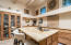 High windows and skylight enhance the beauty of this great kitchen
