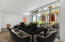 Large area off to kitchen can be perfect for dining. The open concept of kitchen and living provides many options