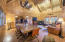 Vaulted tongue and groove pine interior with exposed log beams