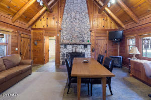 Over 75 acres with well, spring rights, barn and remodeled cabins in the high pines country