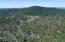 Acreage includes tall pines, aspen, oak, meadows and seasonal tank.