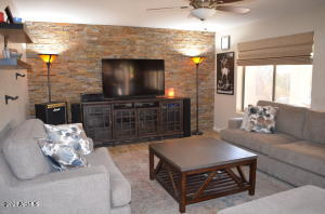 Family room with accent stone wall