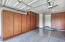 3-Car Garage with Epoxy Coated Flooring and Built-in Cabinets
