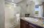 The master bath has a large walk-in shower, dual sink vanity and separate water closet.