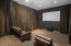 Pop the popcorn, sit back and enjoy a movie in the Media/Movie Room