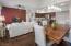 The living space off the kitchen is spacious and bright.
