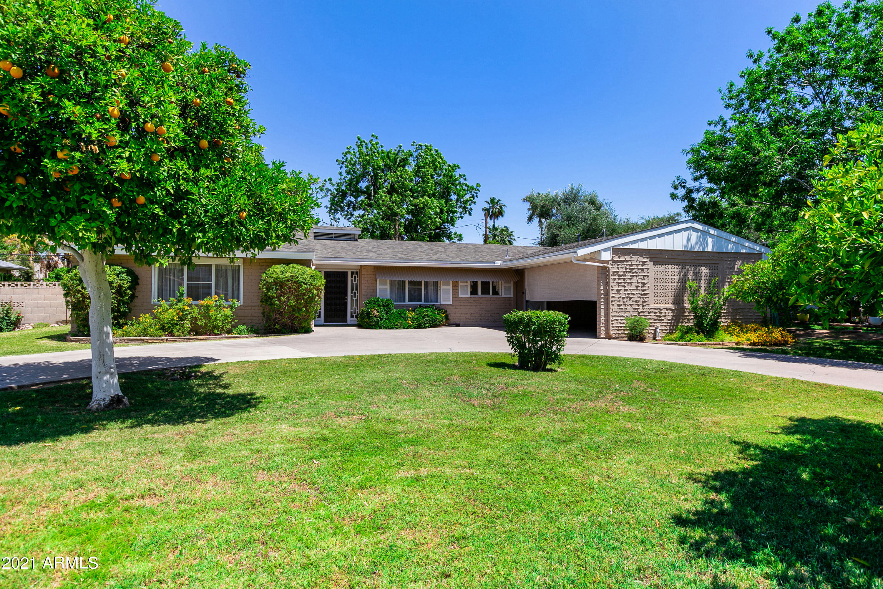 This wonderfully maintained North Central ranch home presents an invaluable opportunity to own a perfectly blank canvas and turn it into the home of your dreams! Even though this home features many of the original finishes, the property has been well taken care of and the pride of ownership is apparent! Sitting on a lush, oversized 11,000+ lot with mature fruit trees and green grass, this brick charmer also offers a spacious carport, a half circle driveway, an enclosed covered porch, large bedrooms, and open living areas. Enjoy easy access to the canal, AZ-51 freeway, and a short distance to several local dining favorites.  Stop by and take a look today!