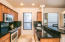 Granite slab counters and back splash with travertine floors