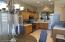 Recessed lighting and tile countertops .