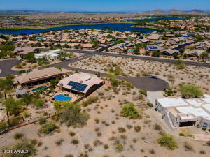 Custom Home Lot in Estrella Mountain Ranch, A Resort Style Master Planned Community. Large Cul-De-Sac Lot is Surrounded by Spectacular Mountain Views and Is Near South Lake and South Lake Park and its Amenities.