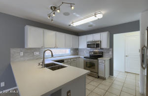 Totally Remodeled Kitchen with Extended Quart Countertops   Stainless Appliances and Lighting