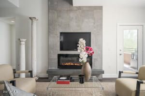 Dramatic 21 foot ceilings in the great room showcase the designer fireplace.