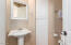 Powder Room/1/2 bath down stairs for guest just inside 3 car garage