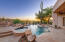 Resort back yard with heated pool and spa